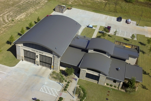 Noticeable Curves Barrel Metal Roof Gives New Fire